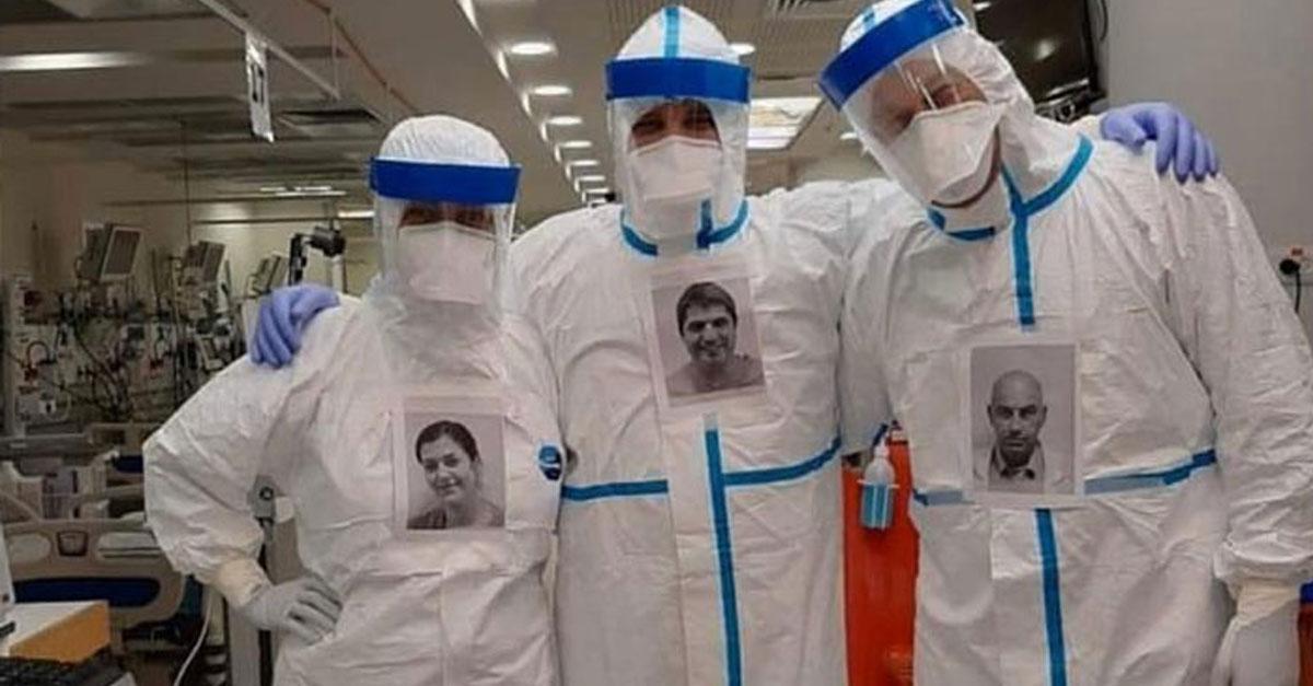แพทย์-ชาวอเมริกัน-แปะภาพถ่ายของพวกเขา-พร้อมรอยยิ้ม-บนชุดป้องกัน-เพื่อสร้างความมั่นใจแก่ผู้ป่วย-COVID-19